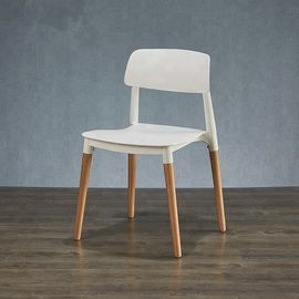 Contemporary Wooden Dining Chairs With White Plastic Sitting Surface